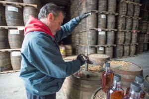 Mike DeMarco uses a pump to extract 20 year old whisky from a barrel housed in Hiram Walker's distillery. (Laura Pedersen/National Post)