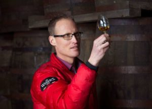 Don Livermore inspects a glass of 20-year-old whisky. (Laura Pedersen/National Post)